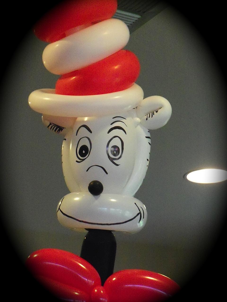art by riki cat in the hat balloon