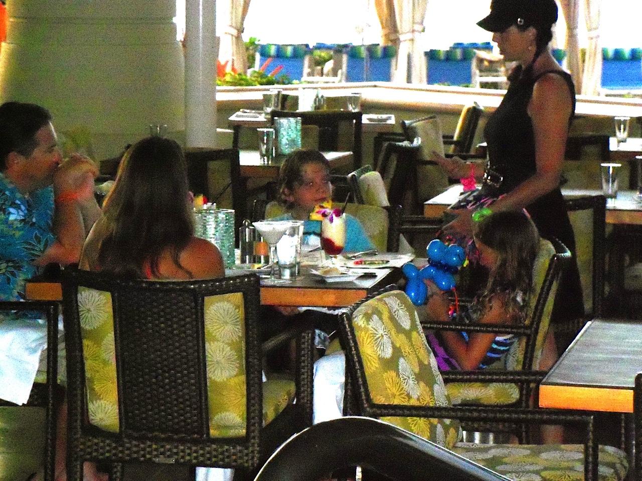 riki at table making balloons